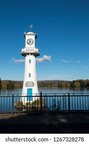 CARDIFF, WALES - NOVEMBER 2018: Roath Park Lake in Cardiff. The lighthouse is the The Scott Memorial in memory of Captain Scott who left from Cardiff on his polar expedition