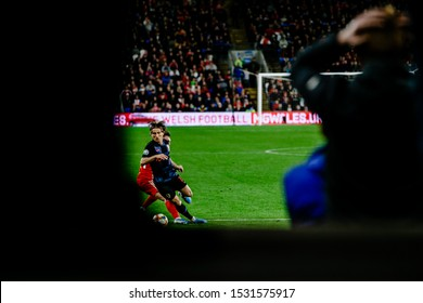 CARDIFF, WALES - OCTOBER 13: Tyler Roberts of Wales tackles Luka Modric of Croatia as fans watch on during UEFA Euro 2020 qualifier between Wales and Croatia at Cardiff City Stadium on October 13, 201