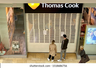 CARDIFF, WALES - SEPTEMBER 2019: Metal roller shutter closed over the entrance to the Thomas Cook travel shop in Cardiff. The company went into administration in September 2019