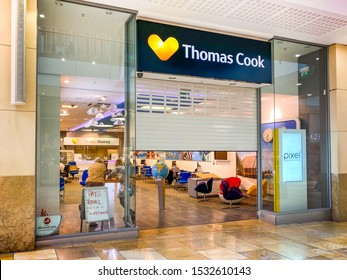 CARDIFF, WALES - SEPTEMBER 2019: Metal roller shutter of the Thomas Cook shop in Cardiff partly open as it re-opens for business. The chain  was taken over by Hays Travel.