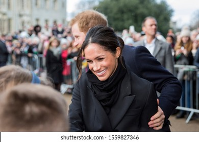 Cardiff, Wales, UK, January 18th 2018. Prince Harry and his fiance Meghan Markle greet schoolchildren on their arrival at Cardiff Castle.