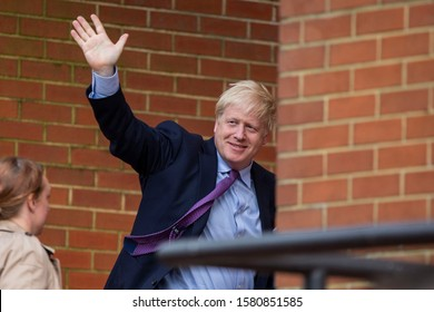 Cardiff, Wales, UK, July 30th 2019. UK Prime Minister Boris Johnson waves at protesters as he arrives at the National Assembly for Wales building.