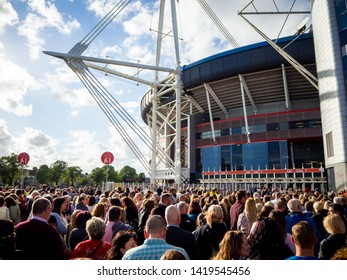 Cardiff, Wales, UK – June 08, 2019:  People queuing and entering the Principality stadium in Cardiff to see a live Take That Music Concert