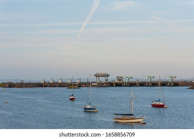 Cardiff, Wales / UK - June 14 2017: Boats in Cardiff Bay with Cardiff Bay Barrage in the background, Cardiff, Wales