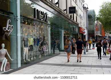 Cardiff, Wales, UK, May 27, 2018: High street retailer Next signage on a modern glass store facade in Cardiff