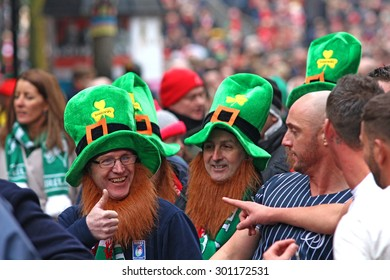 CARDIFF, Wales, UNITED KINGDOM, March 15 , 2015, Ireland Rugby Supporters dressed up as Leprechauns in a crowd of people are coming out of the stadium.