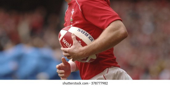 CARDIFF, WALES-FEBRUARY 23, 2008: close up of welsh rugby player holding the ball during the Seix Nations rugby match Wlaes vs Italy at the Millennium stadium, in Cardiff.