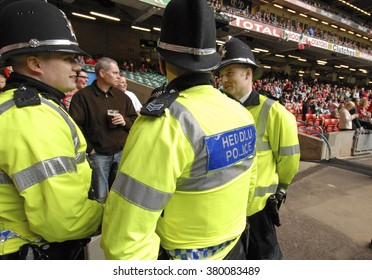 CARDIFF, WALES-FEBRUARY 23, 2008: security policemen at the Millennium stadium during the Six Nations rugby match Wales vs Italy, in Cardiff.
