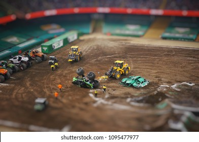 Cardiff,UK - 19th May 2018 : Assistance vehicles helping an overturned mosnter truck durin a Monster Jam event on Principality Stadium in Cardiff.