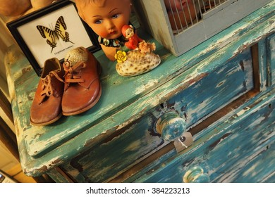 Cardiff,Wales,UK-February 27,2016:antique blue furniture,kids shoes and other vintage objects in an antiques store on 27 february 2016