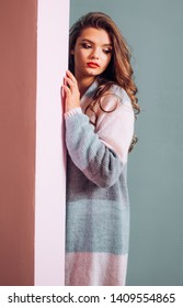 A cardigan featuring her longline silhouette. Casual knitted sweater design trend for fall. Fashion girl wear cute cardigan. Pretty fashion girl with vogue look. Young woman look trendy. Autumn trend.