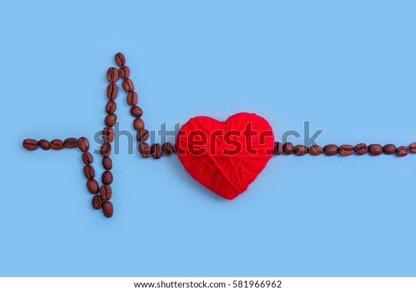 cardiogram of coffee and red heart. Coffee kills. Blue background