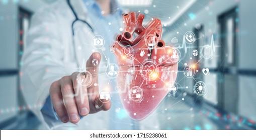 Kardiologe auf unscharfem Hintergrund mit digitaler Röntgenaufnahme der humanen Herz-Holografie-Projektion 3D-Darstellung