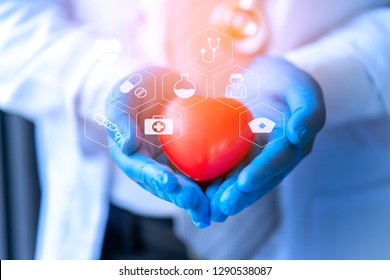 Cardiologist professional doctor develop medicine technology for operate treatment cardio with icon background. Physician specialist take care patient's heart in hands during recuperate in hospital