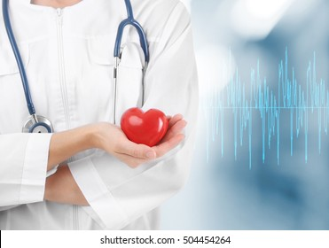 Cardiologist with red heart. Cardiology concept.