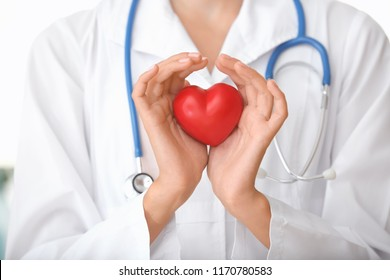 Cardiologist with red heart, closeup