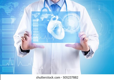 Cardiologist working with virtual screen. Medicine and modern technology concept.