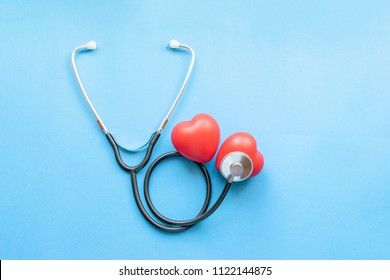 Cardiologist's day, heart disease, Cardiology, black stethoscope with two red hearts on a blue background, diagnosis of heart disease