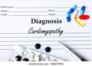 Cardiomyopathy - Diagnosis written on a piece of white paper with medication and Pills