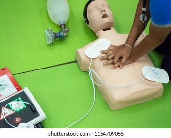 Cardiopulmonary resuscitation (CPR) training on green floor background.Paramedic demonstrate first aid practice for save life.