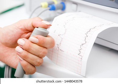 Cardiotocograph machine aka Electronic Fetal Monitor (EFM) recording the fetal heartbeat and the uterine contractions during pregnancy. Cardiotocography (CTG) monitoring concept