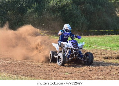 """CARDO, SPAIN - SEPTEMBER 4: Unidentified racer rides a quad motorbike in the """"Promotion Quad Trophy Astur"""" on September 4, 2016 in Cardo, Spain."""