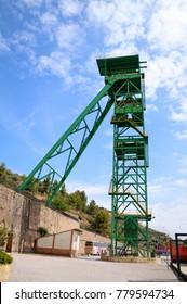 CARDONA, SPAIN – MAY 28, 2014: Green tower of a well extraction of a mine of salt or potash in disuse. Cardona's Salt Mountain Cultural Park. Cardona, Spain.