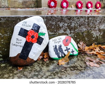 Cardross, Argyll and Bute  Scotland UK – 11-17-2020: gone but not forgotten, hand painted stones at a village memorial site in honour of the fallen, taken on a wet miserable day