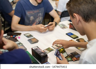 Cards of board game Magic The Gathering are on the table. New expansion game. friends play cards at home. Blagoveshensk, Russia - july 14, 2019