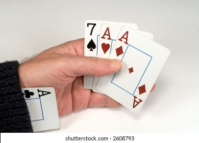 Cards in a hand and an ace in a sleeve