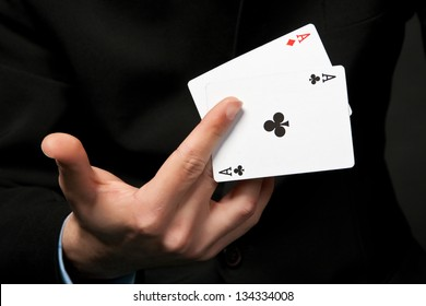 The cards is in the hand of lucky gambler.