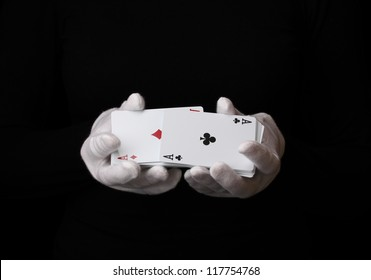 Cards in hands isolated on black