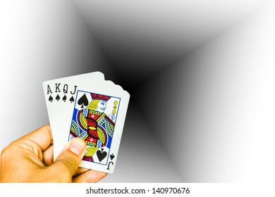 Cards holding by hand on black and white background
