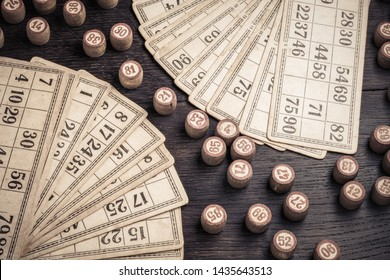 Cards and lotto kegs on a wooden background in vintage style.