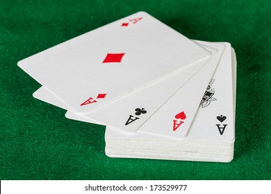 Cards and pack of playing cards on the table.