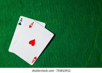cards in poker, two aces on green background with copy space