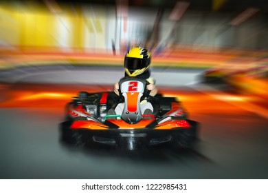 Cards rides at high speed on karting. Race on the track.