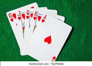 Cards Royal Flush on green background with copy space