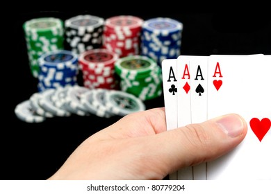 Cards and ultimate poker chips on black