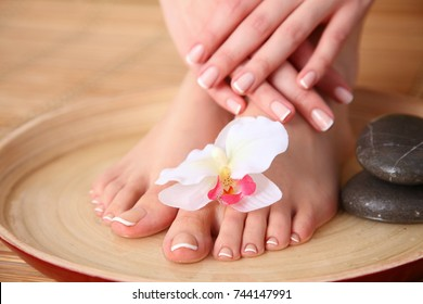 Care for beautiful woman legs with flower. Beautiful woman legs