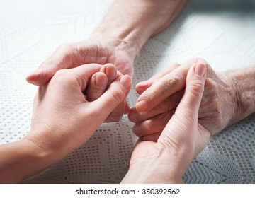 Care is at home of elderly. Senior man, with their caregiver at home. Concept of health caring for elderly old people, disabled. Elderly man.