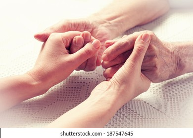 Care is at home of elderly. Space for text. Senior man, woman with their caregiver at home. Concept of health care for elderly old people, disabled. Elderly man.