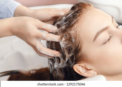 Care of scalp, hair structure against loss and baldness. Wash procedure in sink. Beauty salon spa.