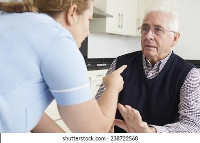 Care Worker Mistreating Elderly Man
