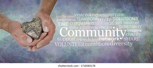 Care for your Community Word Cloud - male  hands holding a wooden rustic heart with the word CARE beside a COMMUNITY word cloud against a rustic stone effect blue grey  background