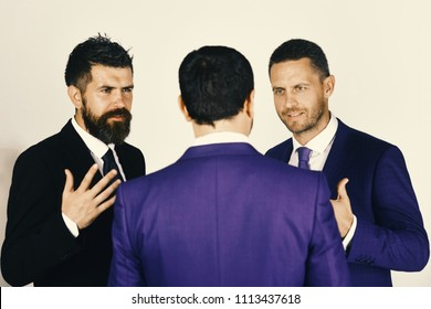 Career and competition concept. Men with beard and persuasive faces discuss business. CEOs have dispute and meeting on light grey background. Businessmen wear smart suits and ties.