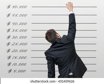 Career concept. Businessman wants raise his income.