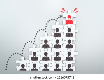 Career development and promotion concept. Going and standing on height. Personal growth and development. Assembling jigsaw puzzle pieces.