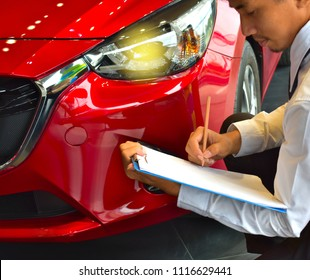 career man saleman business inspection writing on notepad or book, paper with car blurry background.for transport automobile automotive image