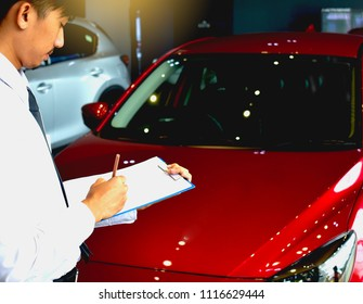 career man saleman business inspection writing on notepad or book, paper with car blurry background.for transport automobile automotive image.